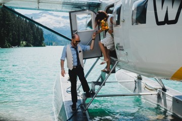 exiting the float plane for wedding in the mountains