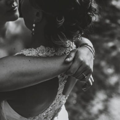 black and white photo of two brides at same sex wedding