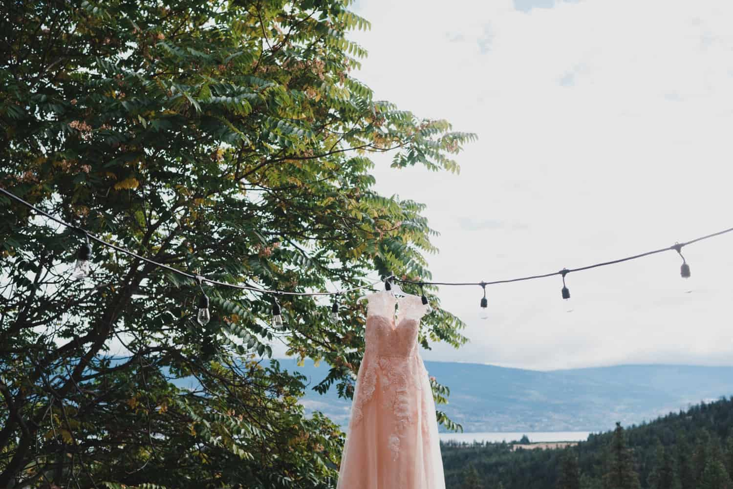 wedding dress hanging on a wire for mountaintop wedding